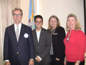 President Tim Strange, December Teacher of the Month Tony Flores - Wiley Post Elementary, Sheryl Rexach - Principal Wiley Post, Caroline Gist - Chair Teacher of the Month Committee